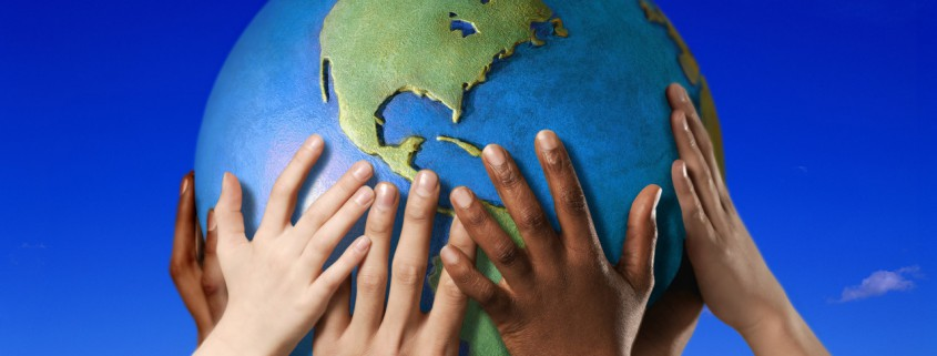 Hands on a globe